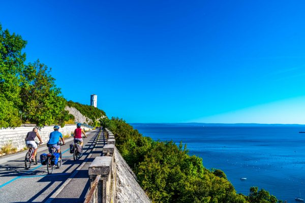 people bike sea italy